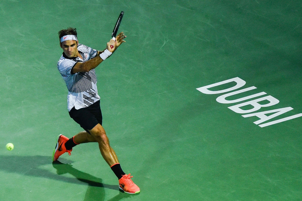 roger federer returns the ball to evgeny donskoy on march 1 2017 in dubai photo afp