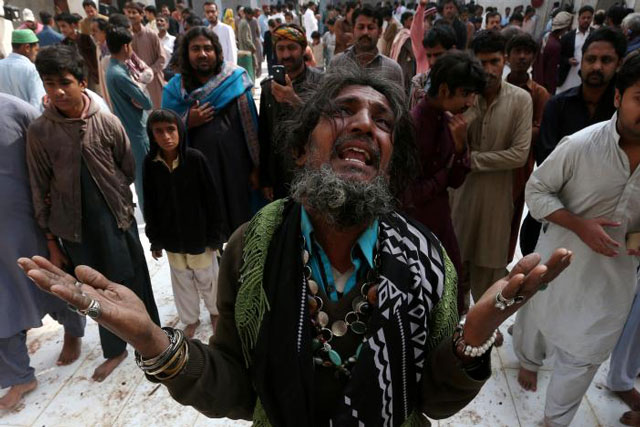 a man mourns the death of a relative who was killed in a suicide blast at the tomb of sufi saint syed usman marwandi also known as the lal shahbaz qalandar shrine in sehwan sindh on february 17 2017 photo reuters file