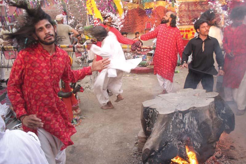 malangs performing dhamal at the urs photo abid nawaz express