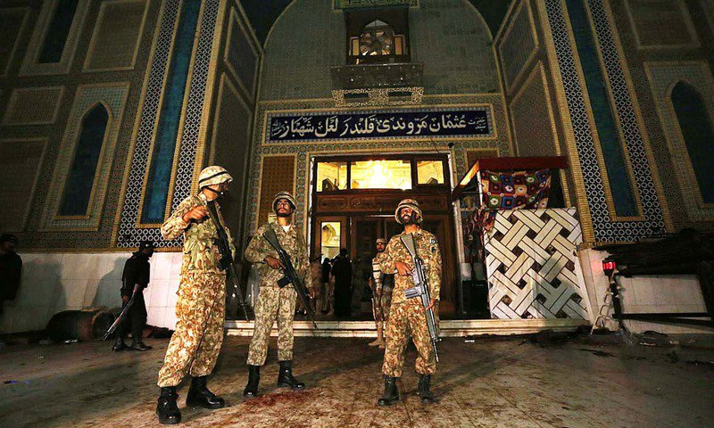 soldiers stand guard outside lal shahbaz qalandar 039 s shrine the shrine was targeted by a suicide bomber on february 16 which claimed over 80 lives photo app