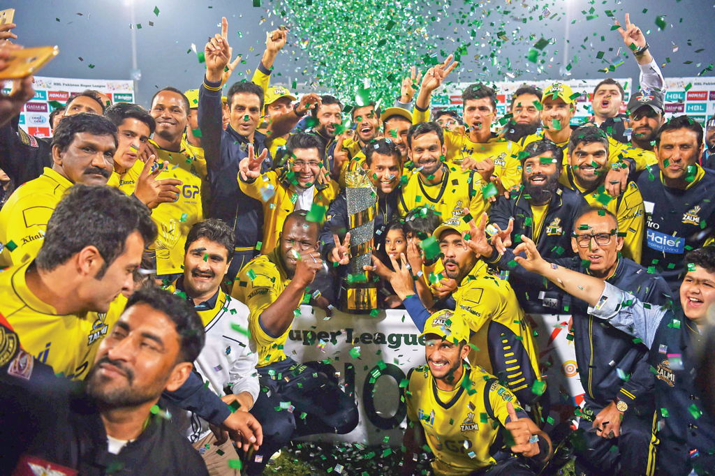 jubilant-peshawar-zalmi-players-pose-with-psl-trophy-in-lahore-photo-afp