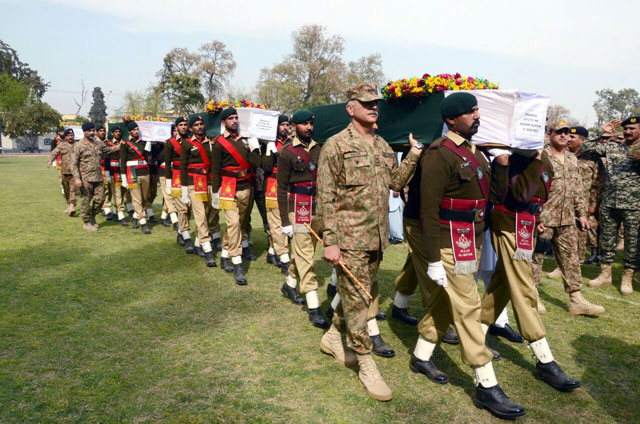Pakistan Army personnel carry coffins of five soldiers who were killed during a Sunday night militant attack in Mohmand Agency. PHOTO: EXPRESS