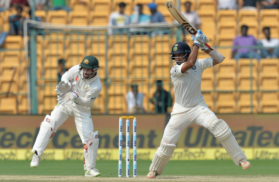 Cheteshwar Pujara punches off the back foot, India v Australia, 2nd Test, Bengaluru, 3rd day, March 6, 2017. PHOTO: AFP