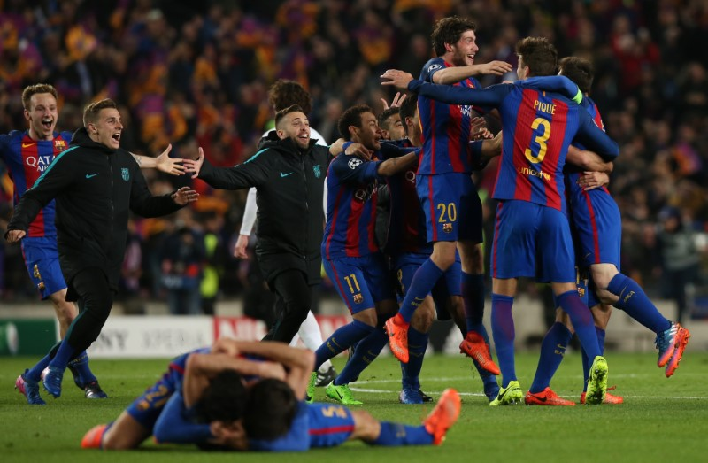 Barcelona players celebrate after the game completing a historic comeback against PSG on March 8, 2017.  PHOTO: REUTERS