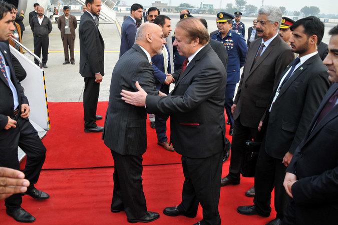 Prime Minister Nawaz Sharif of Pakistan, right, greeted President Ashraf Ghani of Afghanistan, left, in Rawalpindi, Pakistan, on Wednesday. PHOTO: AFP
