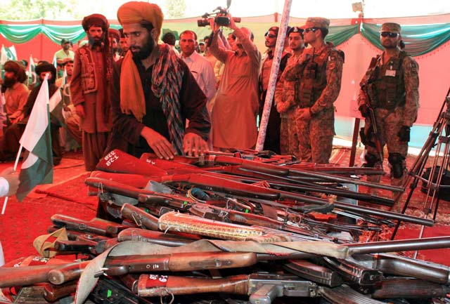 the fighters surrendered their weapons during an independence day ceremony at police lines in quetta photo inp