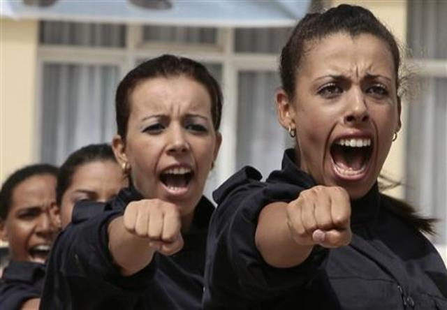 Female police cadets perform during their graduation ceremony at the police academy in Ain Benian August 6, 2009.  PHOTO: REUTERS