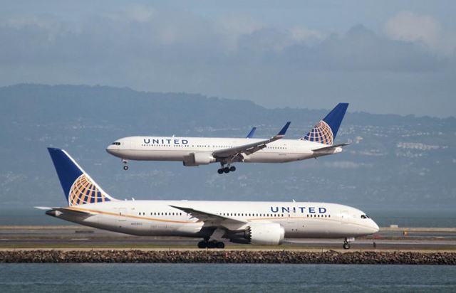 a united airlines boeing 787 taxis as a united airlines boeing 767 lands at san francisco international airport photo reuters