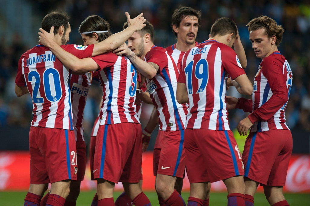 in form atletico get job done against malaga