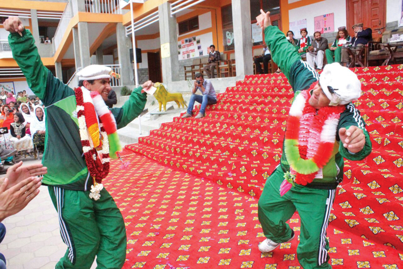 g b special athletes are garlanded and dance at their welcome ceremony photos express