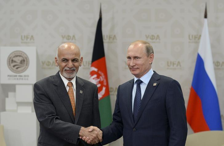 In this file photo, Russia's President Vladimir Putin (R) shakes hands with Afghanistan's President Ashraf Ghani during the Shanghai Cooperation Organization (SCO) summit in Ufa, Russia, July 10, 2015. PHOTO: REUTERS