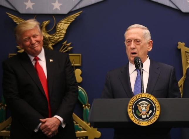 US President Donald Trump listens to  remarks by Defense Secretary James Mattis (R) after a swearing-in ceremony for Mattis at the Pentagon in Washington, US. PHOTO: REUTERS