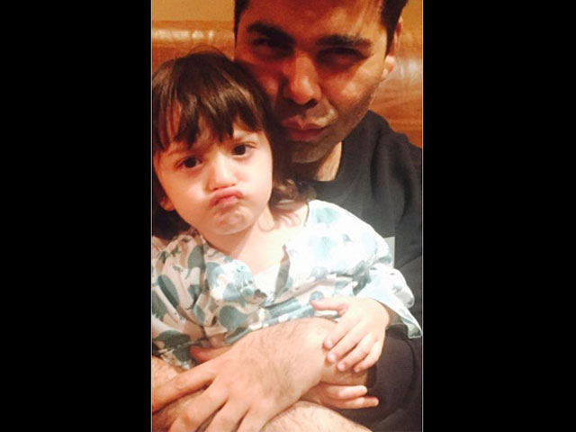 shah rukh s son abram is turning out to be quite the poser karan johar