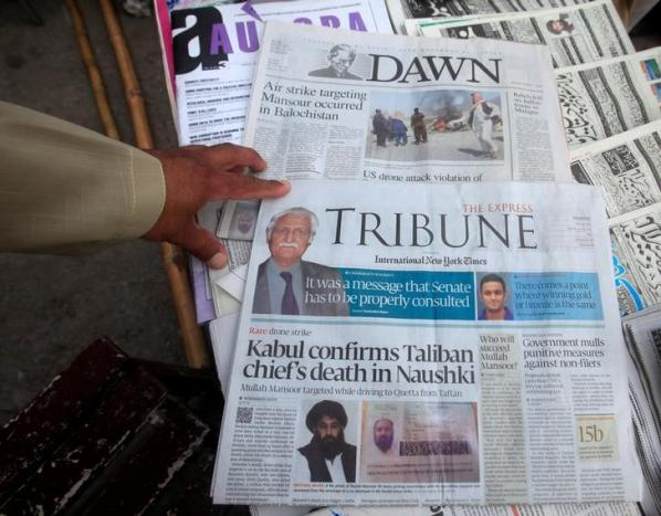 Newspapers containing news about Afghan Taliban leader Mullah Akhtar Mansour are on display at a stall in Peshawar, Pakistan, May 23, 2016.  PHOTO: REUTERS