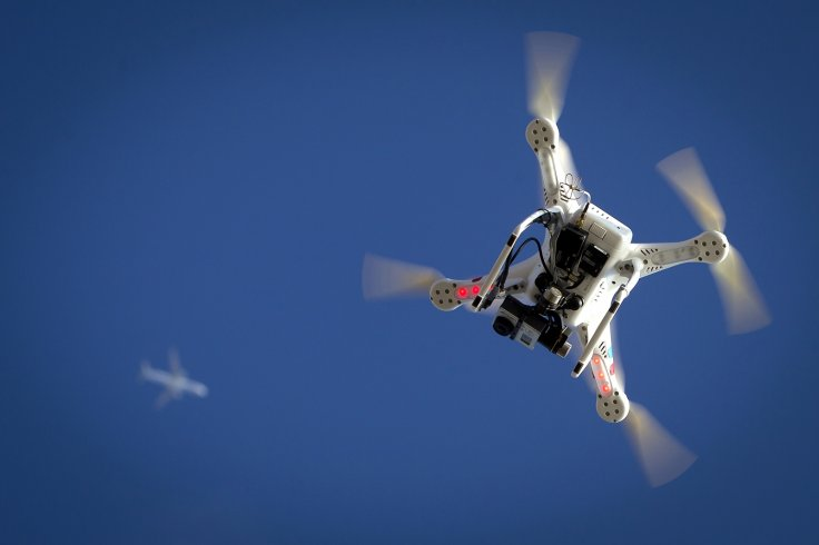 passenger plane comes close to hitting multiple drones in london
