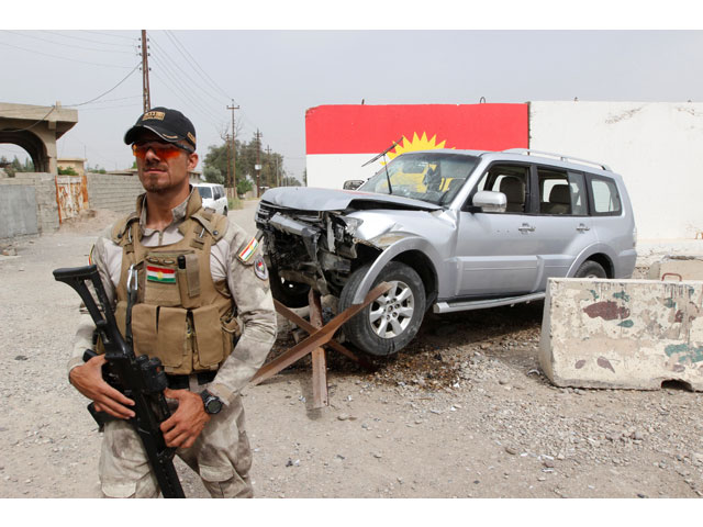 A member of the Iraqi Kurdish security forces stands guard next to the car of Mohammed Younis, a senior official of Iraq's state-run North Gas Company (NGC) who was killed by gunmen, in the northern oil city of Kirkuk, Iraq, May 2, 2017. PHOTO: REUTERS