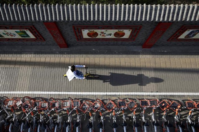 china s sharing app boom floods sidewalks with bicycles