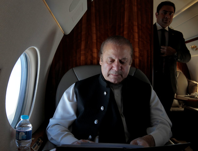 Pakistani Prime Minister Nawaz Sharif works on his official plane as he travels to Karachi to inaugurate the M9 motorway between Hyderabad and Karachi, Pakistan February 3,  2017. REUTERS/Caren Firouz