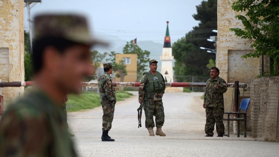Afghan army personnel standing out the military base in Afghanistan. PHOTO: AFP