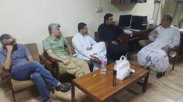 shah mehmood meets detained social media activists at fia office