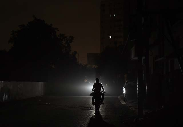 Most parts of Karachi were without power at Sehri time in the wee hours of Sunday. PHOTO: AFP