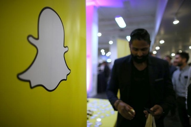 the logo of messaging app snapchat is seen at a booth at techfair la a technology job fair in los angeles california u s january 26 2017 photo reuters