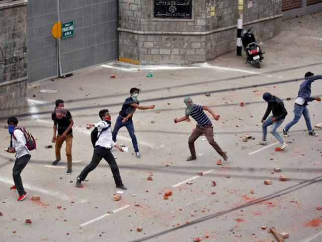 demonstrators throw stones towards the indian police during a protest in srinagar may 9 2017 photo reuters
