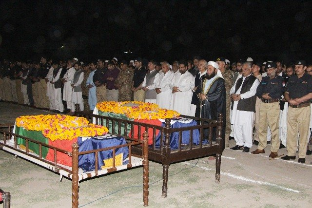 funeral prayers being offered for the slain policemen at the police lines in peshawar photo express