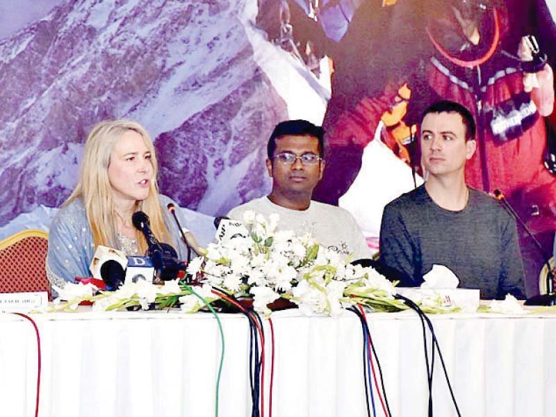 Vanessa O'Brien, along with her team of mountaineers, addresses a news conference in Islamabad. PHOTO: APP
