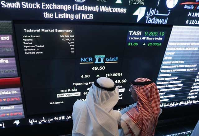 Saudi investors monitor stocks in Riyadh. PHOTO: AFP