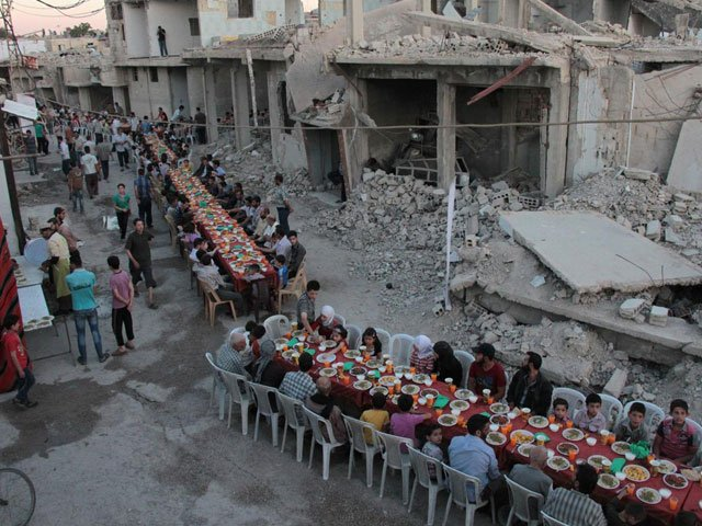 viral pictures of syrian town breaking ramazan fast with iftar among rubble