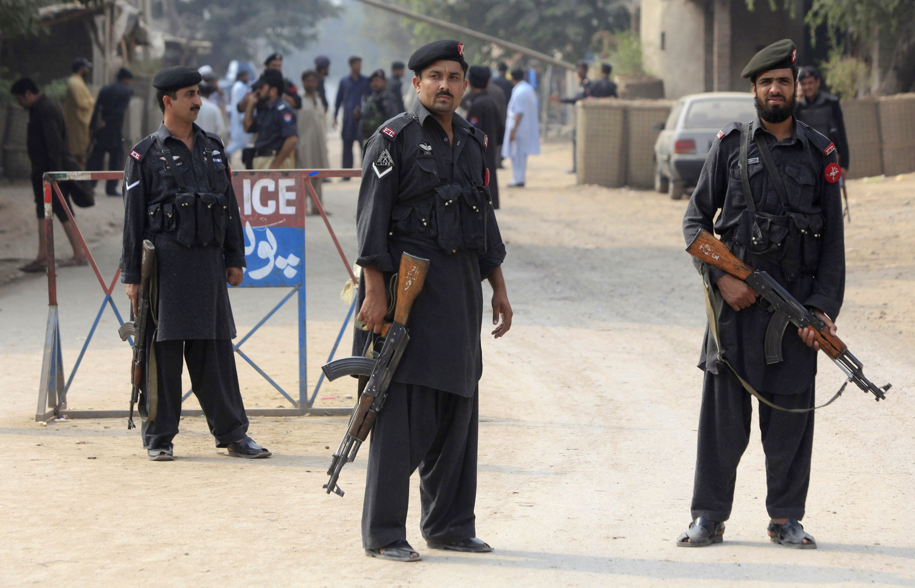 policemen stand guard in shahpur village peshawar on saturday june 24 2017 where a hideout of suspected terrorists was raided photo reuters