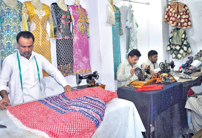 bring on the orders tailors in frenzy to cope with demands
