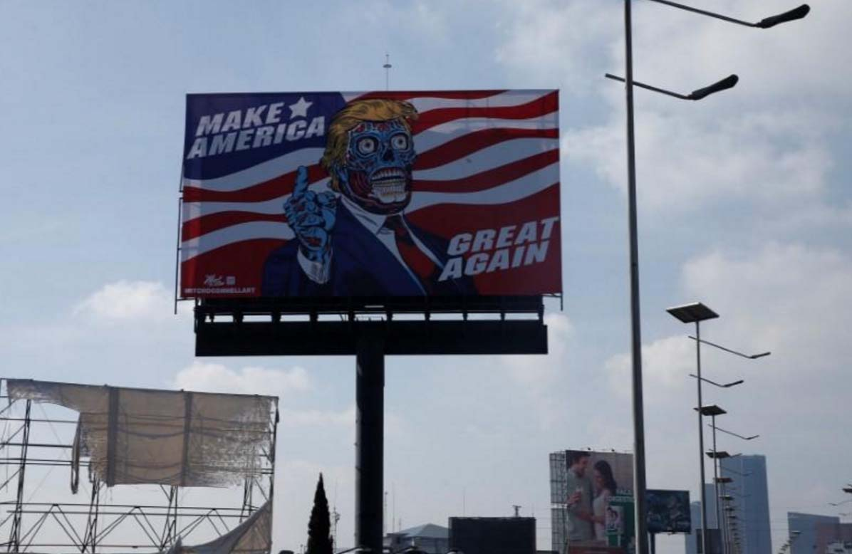 alien trump descends on mexico in artist s billboard