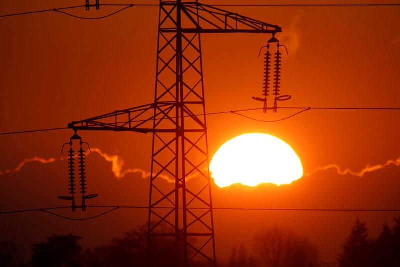 electrical power pylons of high tension electricity power lines are seen at sunset photo reuters