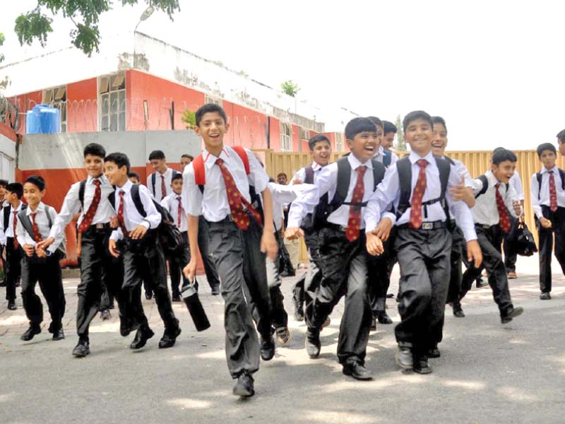 schoolboys returning home on the first day of school after the summer vacations photo inp