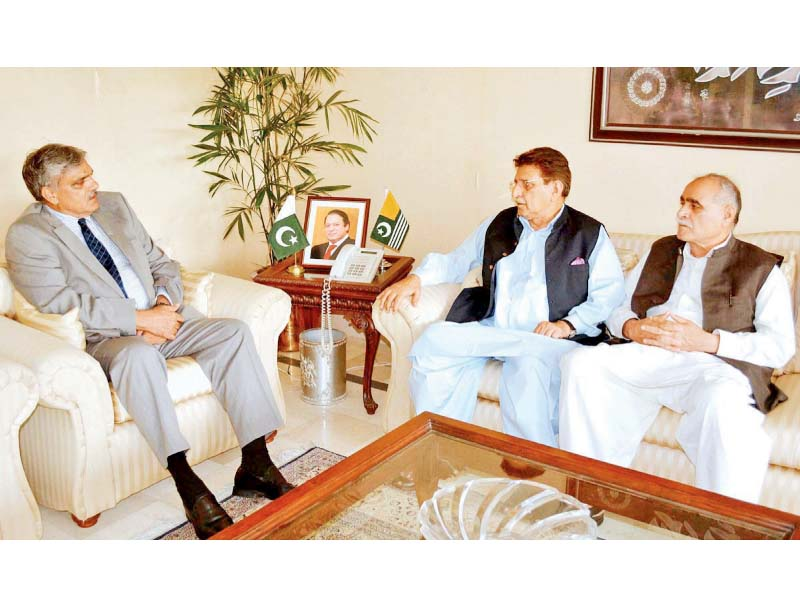 Federal Minister for Kashmir Affairs and G-B, Ch Muhammad Barjees Tahir, meets AJK Prime Minister Raja Farooq Haider. PHOTO: APP
