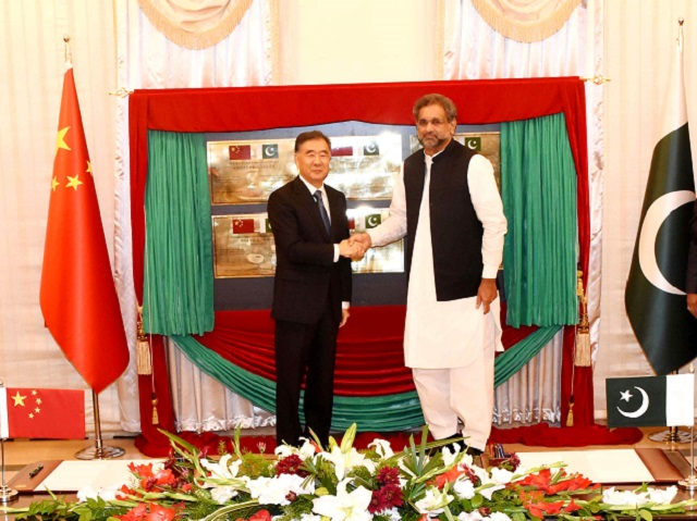 Prime Minister Shahid Khaqan Abbasi and Mr. Wang Yang, the Vice-Premier of the State Council of People's Republic of China after unveiling the plaque for the inauguration of China-Pakistan Economic Corridor (CPEC) energy and infrastructure projects at PM House, Islamabad on August 13, 2017. PHOTO: PID
