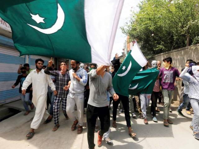 In this file photo, Pakistani flags re being hoisted and carried during a rally in Srinagar, Kashmir. PHOTO: REUTERS