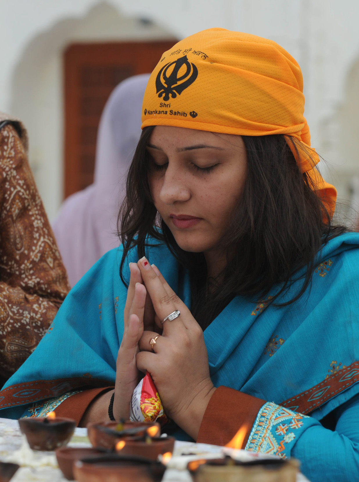 In this file photo, a Sikh devotee from India prays during the 542nd birth anniversary of Guru Nanak Dev at Nankana Sahib. PHOTO: AFP