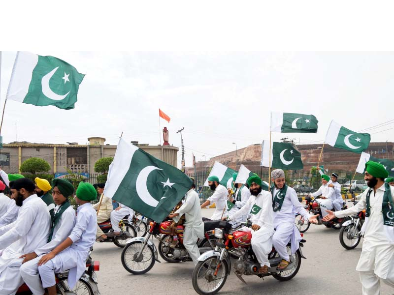 Sikhs take part in Independence Day rally. PHOTO: AFP