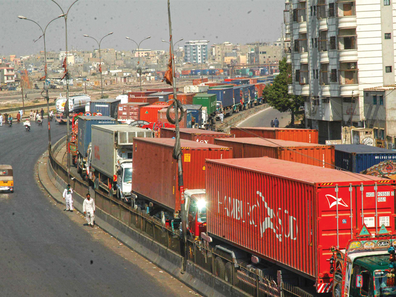 trucks laden with containers caught in a massive gridlock on mauripur road photo express file
