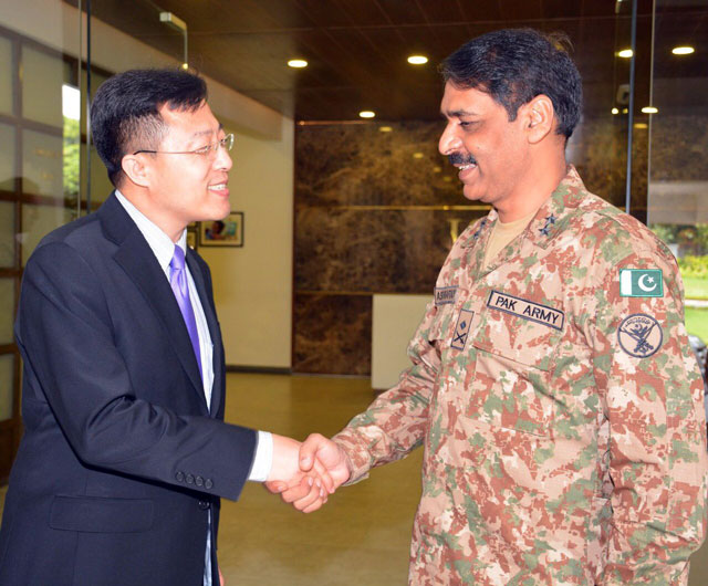 Chinese DCM Lijian Zhao shakes hands with head of military's media wing Maj-Gen Asif Ghafoor upon his arrival at the ISPR directorate in Rawalpindi on Wednesday, August 23, 2017. PHOTO: ISPR