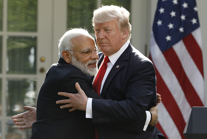 India's Prime Minister Narendra Modi hugs US President Donald Trump as they give joint statements in the Rose Garden of the White House in Washington, US June 26, 2017. REUTERS/