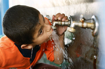 a child drinking water from the tap photo reuters