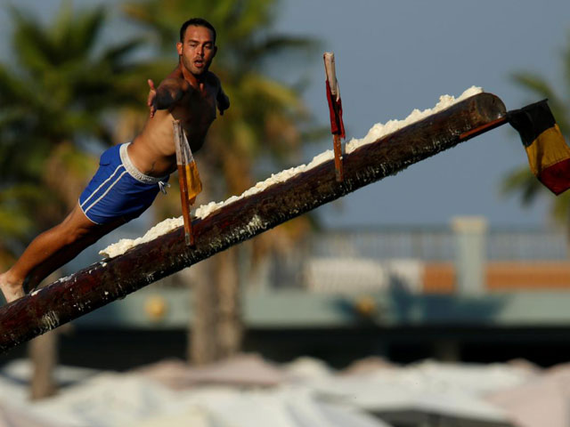 at maltese festival climbing the greasy pole is part of the fun