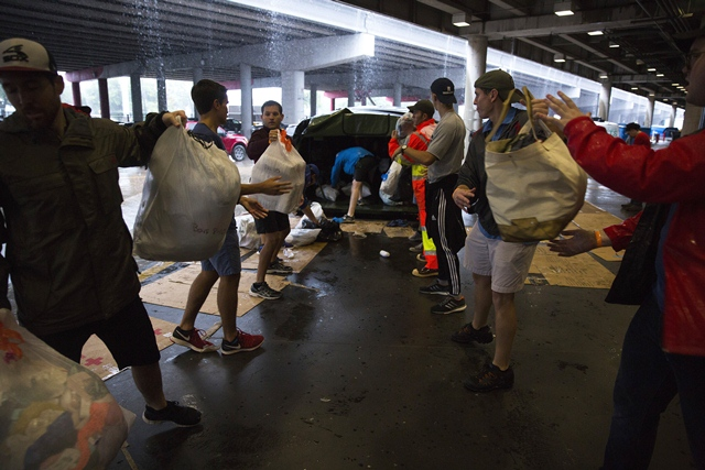 volunteers unload donated items at the george brown convention center which has been turned into a shelter run by the american red cross to house victims of the high water from hurricane harvey on august 28 2017 in houston texas photo afp