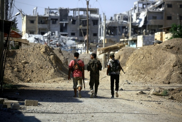 64 dead in clashes between syria regime and is