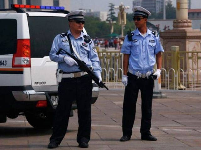 shanghai punishes cop who downed woman child in parking ticket row
