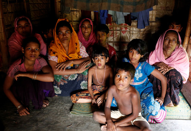 A group of Rohingya refugees takes shelter at the Kutuupalang makeshift refugee camp, after crossing the Myanmar-Bangladesh border today in Cox's Bazar, Bangladesh, August 26, 2017. PHOTO: REUTERS